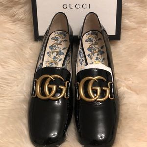 Gucci patent shoes.